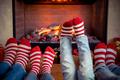 Feet in Christmas socks near fireplace - PhotoDune Item for Sale