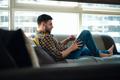 Man Choosing Movie For Streaming On Tablet - PhotoDune Item for Sale