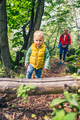 Young boy hiking with mother, family adventure - PhotoDune Item for Sale