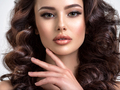 Beautiful woman with brown hair. Beautiful face of an attractive model with beige makeup. - PhotoDune Item for Sale