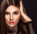 Woman with beauty long brown hair. Beauty woman with living coral color lipstick on lips. - PhotoDune Item for Sale
