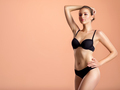 Young girl in black underwear with an ideal body, posing in the studio. - PhotoDune Item for Sale