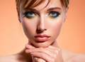 Face of an young girl close-up with a green color makeup. Stylish makeup. - PhotoDune Item for Sale