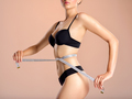Young woman with tape and a beautiful, healthy body. Sexy woman measuring her perfect body. - PhotoDune Item for Sale