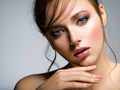Closeup face of young beautiful woman with a healthy clean skin. - PhotoDune Item for Sale