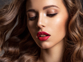 Beautiful face of young woman with red lipstick. Portrait of a stunning sexy girl looks at camera. - PhotoDune Item for Sale