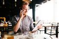 Bsuinessperson multitasking even during break - PhotoDune Item for Sale