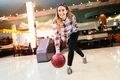 Cheerful friends bowling together and having fun - PhotoDune Item for Sale