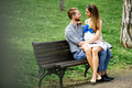 Beautiful couple taking a walk in city park - PhotoDune Item for Sale
