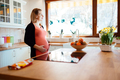 Beautiful pregnant woman in kitchen - PhotoDune Item for Sale