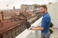 Business person using laptop outdoor on rooftop - PhotoDune Item for Sale