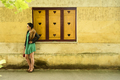 Fashionable woman in front of yellow wall - PhotoDune Item for Sale