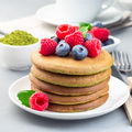 Matcha pancakes served blueberry and raspberry on white plate, square format - PhotoDune Item for Sale
