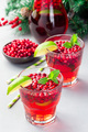 Lingonberry and lime punch or limeade in glass, christmas tree decoration on background, vertical - PhotoDune Item for Sale