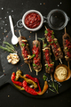 Grilled sausages and vegetables with  spices and fresh herbs on dark background - PhotoDune Item for Sale