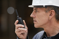 Construction Worker Speaking by Radio Side View - PhotoDune Item for Sale
