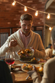 Mature Man Serving Food at Dinner Party - PhotoDune Item for Sale