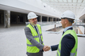 Business People Shaking Hands at Construction Site - PhotoDune Item for Sale