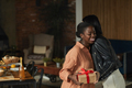 Woman Welcoming Friend to Dinner Party - PhotoDune Item for Sale