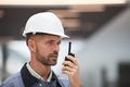 Construction Worker Speaking by Walkie-Talkie - PhotoDune Item for Sale
