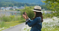 Woman takes photo with cellphone in countryside - PhotoDune Item for Sale