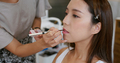 Asian woman having make up by artist in the studio - PhotoDune Item for Sale