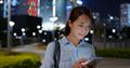 Woman look at mobile phone at night - PhotoDune Item for Sale