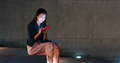 Woman use of mobile phone and sit at the park - PhotoDune Item for Sale