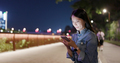 Asian Woman use mobile phone online at night - PhotoDune Item for Sale