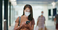 Woman wear face mask and use of smart phone at outdoor - PhotoDune Item for Sale