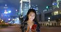 Woman search on cellphone in city at night - PhotoDune Item for Sale