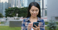 Woman use of mobile phone for text message in city - PhotoDune Item for Sale
