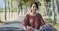 Woman ride a bike in countryside - PhotoDune Item for Sale