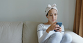 Woman use of mobile phone and apply paper mask on face - PhotoDune Item for Sale