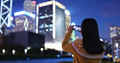 Woman take photo on cellphone in city at night - PhotoDune Item for Sale