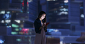 Woman work on mobile phone over the city at night - PhotoDune Item for Sale
