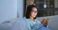 Woman with glasses and use of mobile phone at home - PhotoDune Item for Sale