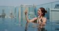 Woman take photo inside swimming pool - PhotoDune Item for Sale