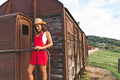 Beautiful Young girl Smiling and Using Smartphone at the Back of an Old Vintage Train Wagon - PhotoDune Item for Sale