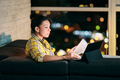 Woman working from home at night - PhotoDune Item for Sale
