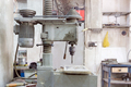 Old drilling machine in the production hall. Close-up. - PhotoDune Item for Sale