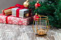 Festive background with gift boxes, Christmas tree and candle - PhotoDune Item for Sale