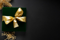 Wrapped gift with baubles on dark background - PhotoDune Item for Sale