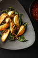 Roasted potatoes with mushrooms and basil on a plate - PhotoDune Item for Sale