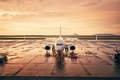 Airplane at airport during golden hour - PhotoDune Item for Sale