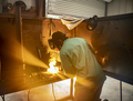A man welds two pieces of metal together in a shot with an arc welder. - PhotoDune Item for Sale