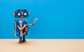 A smiling robot with a blue head and torso. - PhotoDune Item for Sale