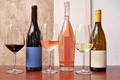 Three different kind of bottles of wine and three glasses - PhotoDune Item for Sale