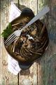 Plate of baked artichokes with juniper berries - PhotoDune Item for Sale