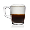 Transparent glass cup of espresso macchiato coffee isolated on white. - PhotoDune Item for Sale